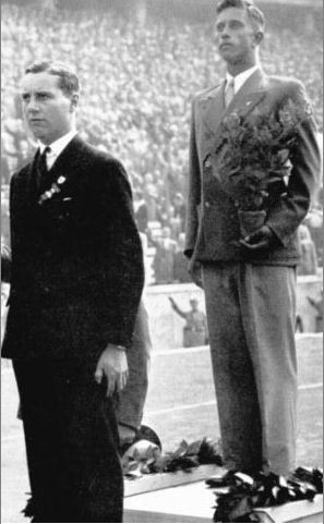 Photo of (Sir) Peter Scott receiving medal 1938 Olympics