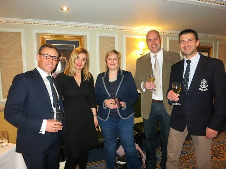 Photo of five people for drinks party